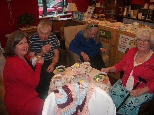 Resident's enjoy tea and cake in the cafe