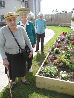 Residents enjoy the spacious garden at Carrickfergus Manor