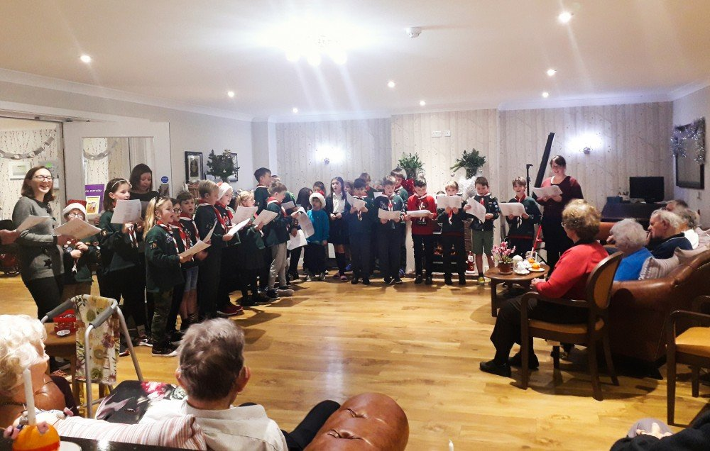 Low Furlong residents stay busy with carol service, kitten therapy and festive fun