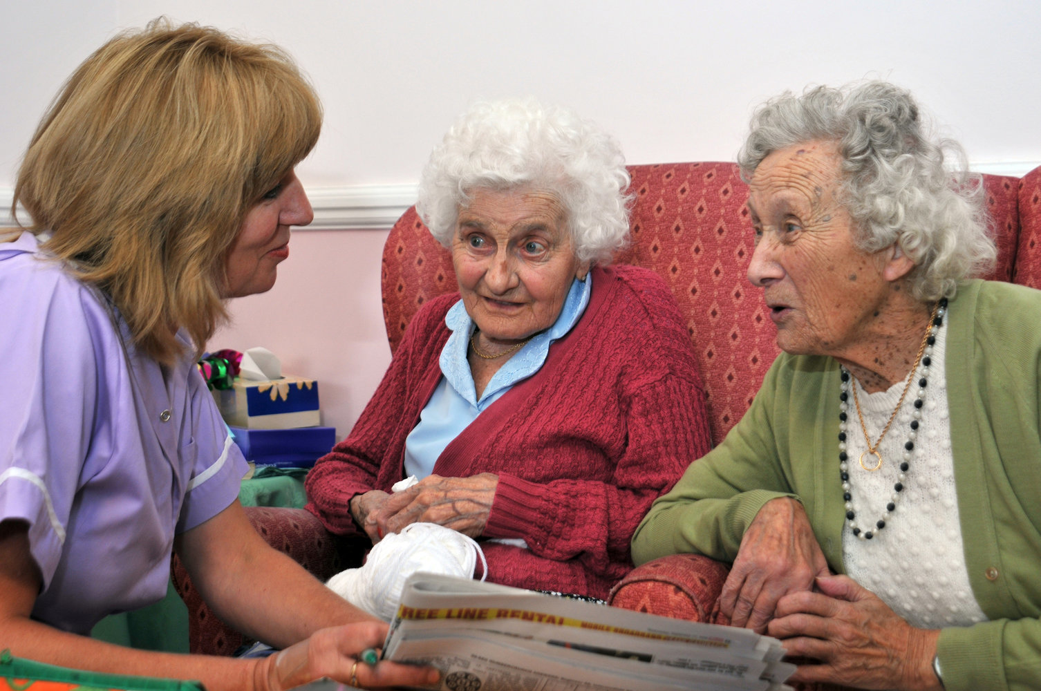 Residents and Carers look at newspaper