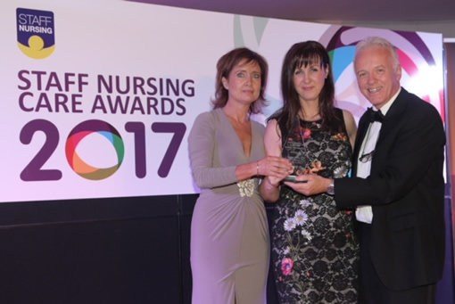 Noel Thompson presenting Siobhan Conway and Ann-Maire Conway with Highly Commended Nursing Home of the year 2017 for Magherafelt Manor.