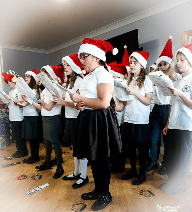 Dunmurry Primary Choir visit Oak Tree Manor for Christmas Carol Concert.