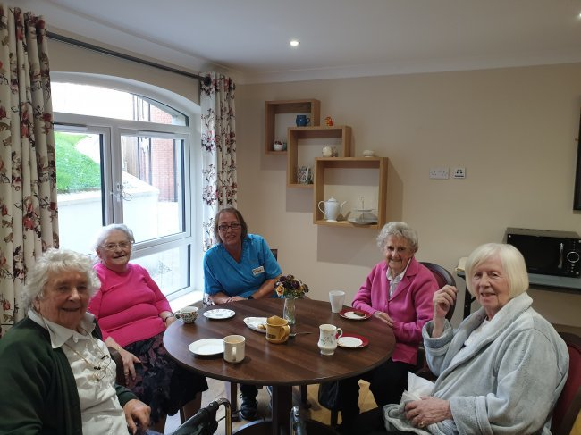 Residents at Glenabbey Manor in County Antrim, Northern Ireland, host breakfast club.