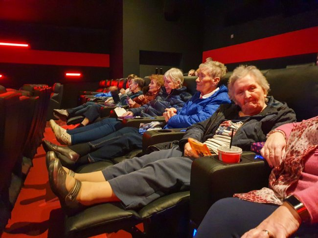 Residents at Glenabbey Manor take trip to local cinema for 'Singing in The Rain' showing.