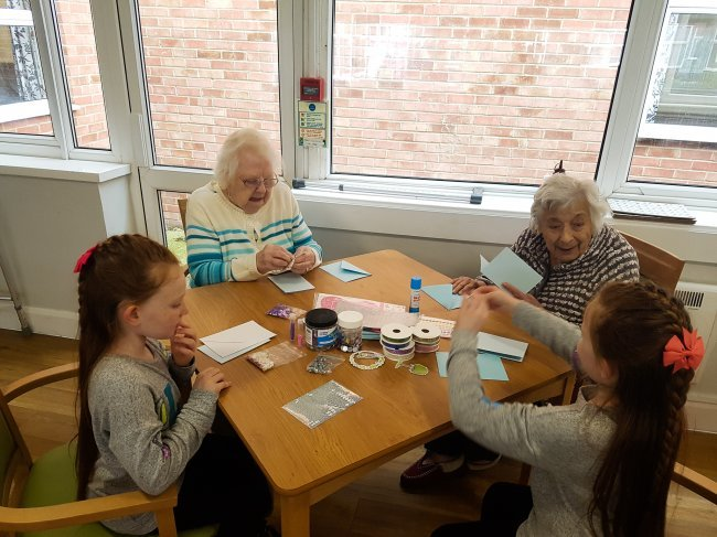 Longview residents welcome children from the local community for arts and crafts session.