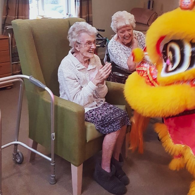 Elizabeth House residents celebrate Chinese New Year with Traditional Chinese Dragon performance.