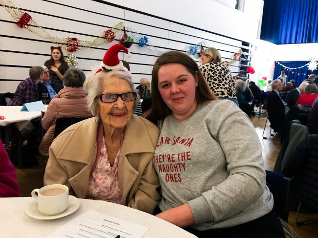 Humfrey Lodge residents participate in Senior Citizens' Christmas Party at local school.