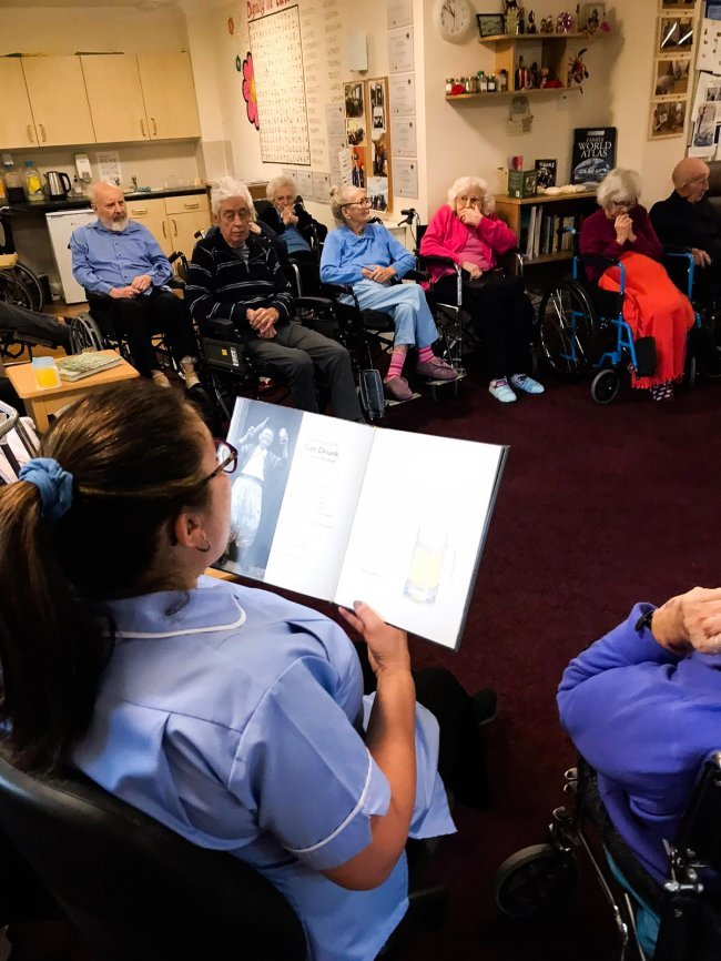 Residents at Frank Foster House read poetry together.
