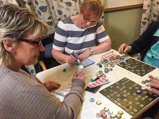 Oldfield Houses' cook, Gail Burkill, hosts community bingo night.