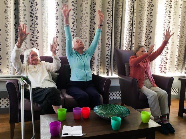 Residents at Broomhills keep busy with at-home pub night and intergenerational play group.