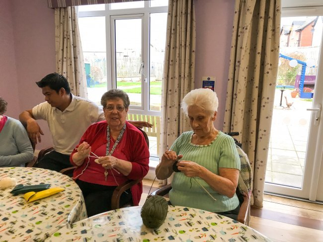 Residents at Carrickfergus Manor in Northern Ireland keep busy during their weekly 'Knit and Natter' session.