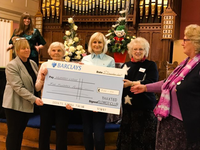 Thaxted Flower Club present Humfrey Lodge residents with £200 cheque.