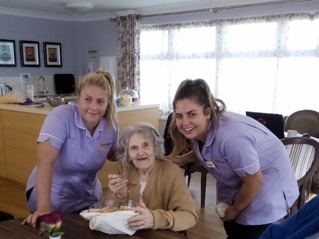 Residents and staff come together during 'Tools Down' to make cakes at Bracebridge.