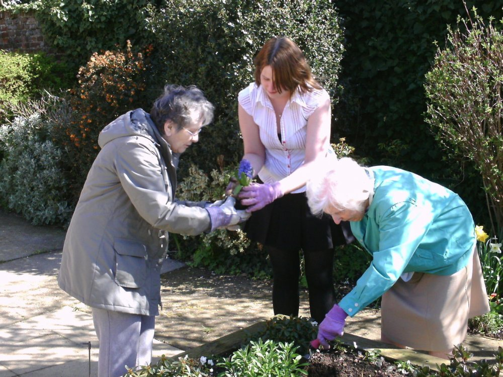 Resident's enjoy time in the garden with our expert carers