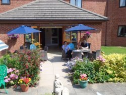 Residents and Carers enjoy the garden