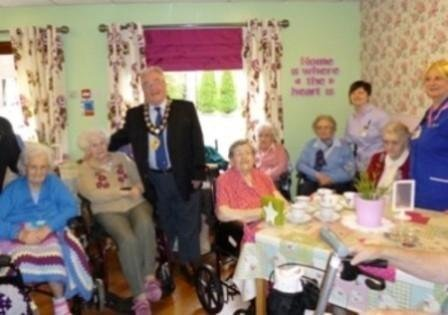 Residents and experienced carers enjoy the tea room