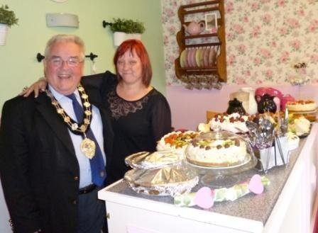 Kintullagh manager celebrates the tea room's opening with Alderman McAcvoy